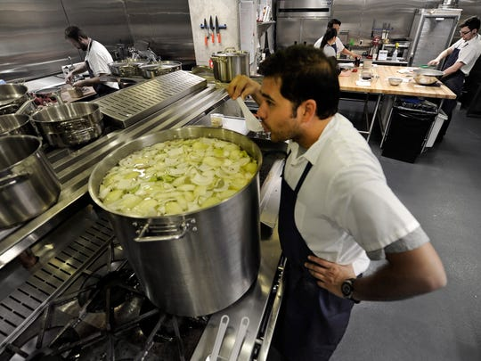 Executive Chef Sal Avila gets the kitchen ready for the opening of Prima, a much-anticipated restaurant. Prima is set to open in the Gulch soon  on Monday Oct. 27, 2014, in Nashville in Tenn.