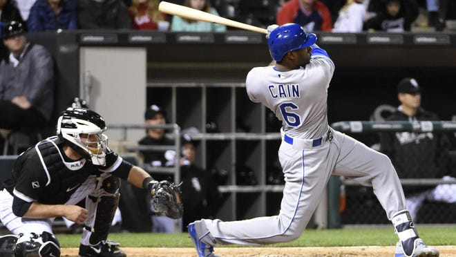 Kansas City Royals' Lorenzo Cain (6) hits an RBI double against off of Chicago White Sox pitcher Jose Quintana during the sixth inning Friday in Chicago. Cain's hit gave the Royals the lead for the first time in the game.