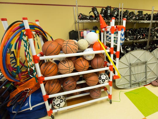 Various sporting equipment is stored in a room at White
