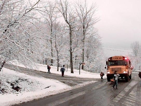 Vermont school bus in the snow.