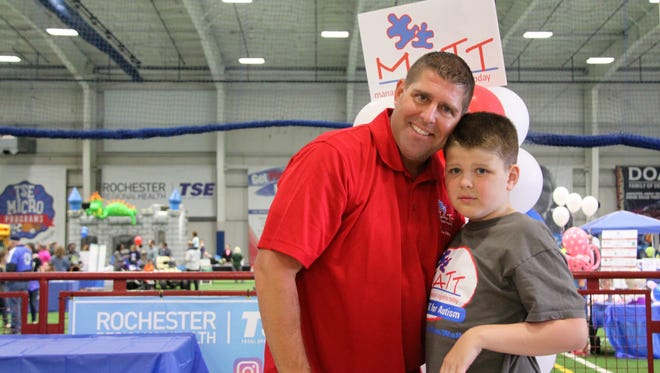 """Kevin Schoenl, of Pittsford, with his son Matthew """"Matt"""" Schoenl, 10, at Total Sports Experience in Gates for the 6th Annual Autism Spectrum Connection Fair on April 29, 2017.  Kevin organizes the fair each year as the director of Managing Autism Together Today (MATT)."""