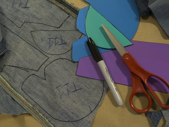 """A sample of a shoe pattern for the """"Sole Cutting Party"""" hosted by the United Methodist Church in Madison. Approximately 40 members of the church and community met on Nov. 22 to cut pattern pieces out of donated blue jeans to make shoes for children in Uganda."""