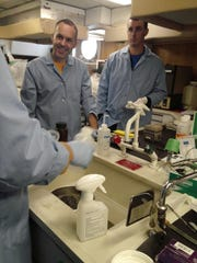 Researcher Tim Hoeillein, left, and teacher Quinn Loch,