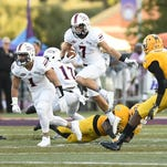 Northwestern State's Ed Eagan tries to get past Southeastern Louisiana defenders during Thursday night's game.