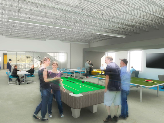 FitzMark's new building at 940 Dorman St. will have an open, industrial feel with a social hub -- a pool table and ping-pong.