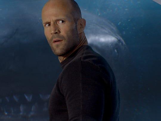 Does Jonas (Jason Statham) know that big shark is behind