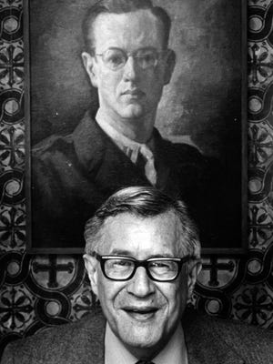Walter I. Farmer with a World War II portrait of himself in 1979.