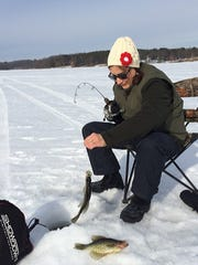 Penny Durkin lands her second crappie while fishing Feb. 11 on Turtle Lake.
