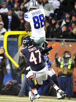 CHICAGO, IL - DECEMBER 4: Dez Bryant #88 of the Dallas Cowboys makes a catch over Chris Conte #47 of the Chicago Bears during the third quarter a game at Soldier Field on December 4, 2014 in Chicago, Illinois. (Photo by David Banks/Getty Images)