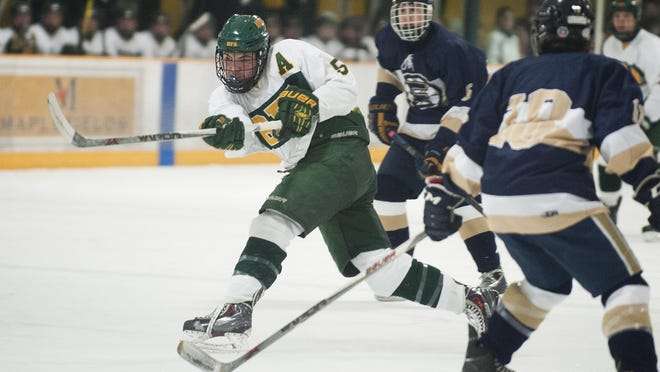 BFA's Matt Needleman (5) shoots the puck during the boys hockey game between the Essex Hornets and the BFA St. Albans Bobwhites at the Collins Perley Complex on Wednesday night.