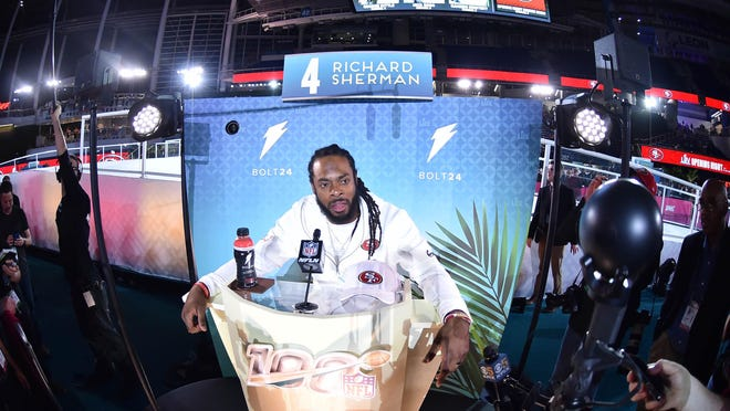 49ers cornerback Richard Sherman is interviewed during Super Bowl LIV Opening Night at Marlins Park.
