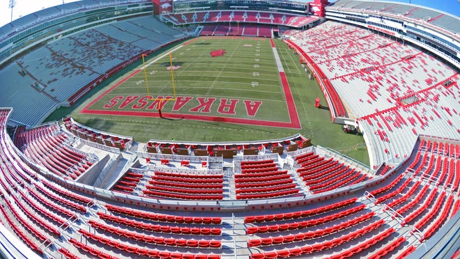 An overview of Donald W. Reynolds Razorback Stadium, as seen from the north end zone. The University of Arkansas set a cap on home football game attendance at 17,000 for the 2020 season in response to the cornavirus pandemic. There are 33,000 season ticket holders and 1,600 student ticket holders for the 76,400-seat stadium.