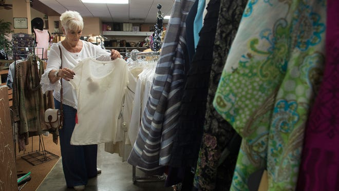 Sally Youngstrom shops at Cecilia's Elite Repeat consignment boutique on U.S. 41 in Fort Myers. Youngstrom is a weekly visitor to the shop.