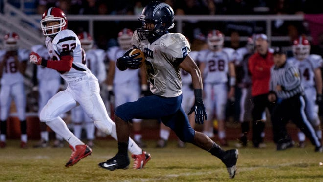 Timber Creek's Kareem Ali heads downfield with Kingsway Dragon Lackley Avanti hot on his trail during the playoff game between Timber Creek and Kingsway on Nov. 22, 2013. Tracie Van Auken for the COURIER-POST