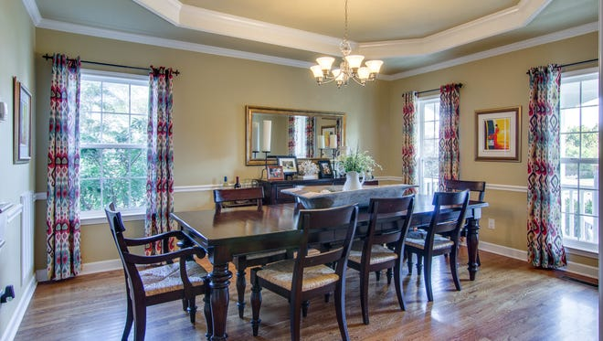 The Spring Hill home at 3000 Helfrich Court shows a less formal style that is the decorating trend for so-called formal dining rooms. The dining room is sizable for a house in its price range ($350,000).