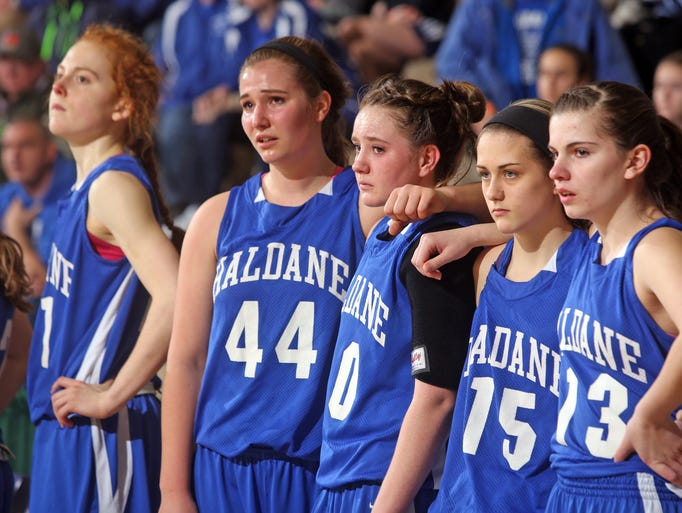 Haldane's Cali Schweikhart, left, Shauna Ricketts, Allie Monteleone, Clare Dahlia, and Allison Marino watch the final seconds of their New York State Girls Basketball Championship Class C semifinal game against Chautauqua Lake at Hudson Valley Community College in Troy March 15, 2014. Chautauqua Lake defeated Haldane 61-39.