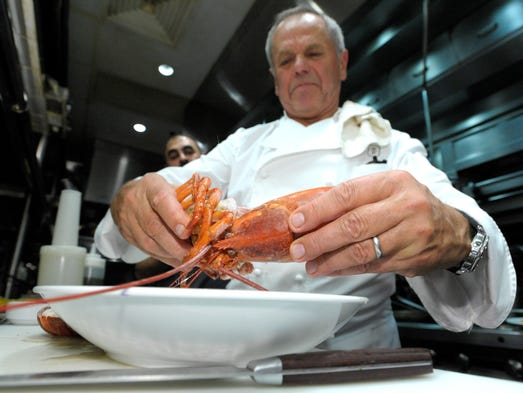 Wolfgang Puck breaks up a Lobster for Lobster Pasta.