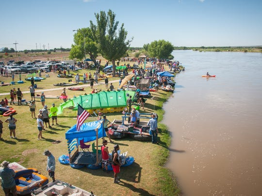 Rafters gather on the banks of the Rio Grande at Llorona Park before the start of last year's Raft the Rio event. Rafters complete their run at Mesilla Valley Bosque State Park.