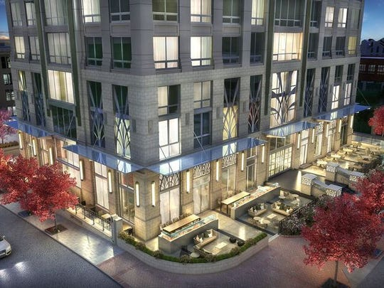 The Arras hotel/condominium building will create a much more pedestrian friendly lower level, with two restaurants on the first floor, as this rendering depicts.