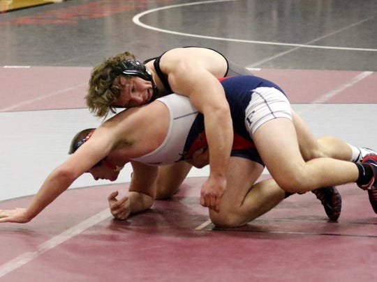Elmira's Charlie Mahon, top, was a 12-0 winner over Braxton Stout-Moran of Chenango Forks in the 182-pound final Saturday at the Elmira Christmas Tournament at Elmira High School.