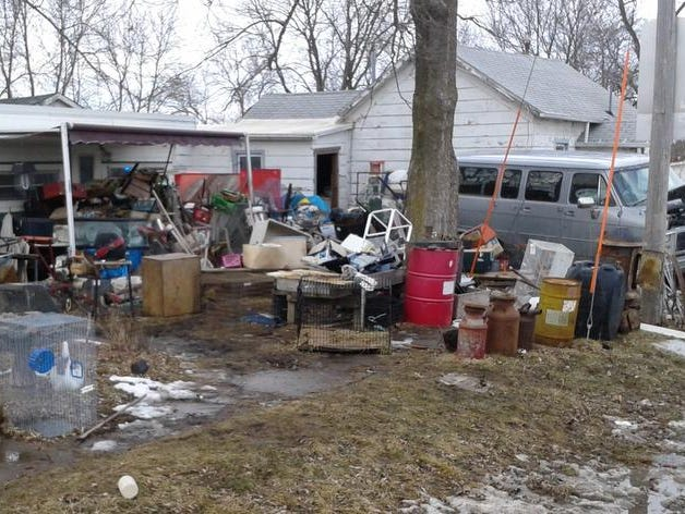 This is the Drakesville property where Roger Blew lived with more than 300 dead or neglected animals until his February arrest. Some outbuildings had 6 inches of feces in them.