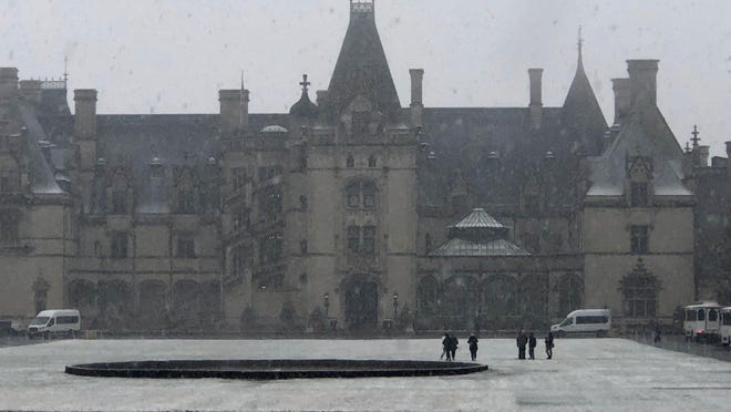 Celebrating its 125th anniversary this year, the Biltmore House, America's largest home with over four acres of floor space including 35 bedrooms and 43 bathrooms, looks austere and stately in a snowstorm.