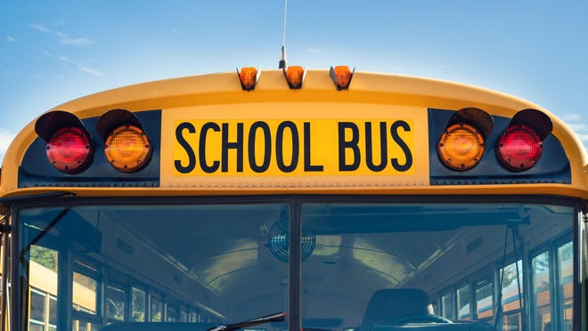 Front closeup view of a yellow school bus