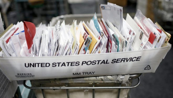 A tray of mail at the United States Postal Service Processing and Distribution Center in San Francisco on Dec. 16, 2013.
