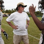 Merritt Island head football coach Jeff McLean (center) is always anxious to get started.