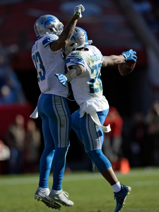 Detroit Lions cornerback Quandre Diggs (28) celebrates with cornerback Darius Slay Jr., (23) after Diggs intercepted a pass by Tampa Bay Buccaneers quarterback Jameis Winston during the second half of an NFL football game Sunday, Dec. 10, 2017, in Tampa, Fla. (AP Photo/Jason Behnken)