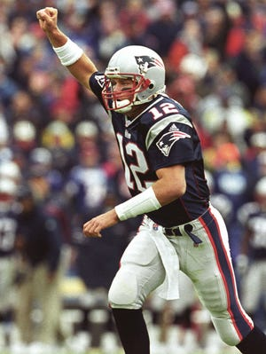 New England Patriots quarterback Tom Brady on Sept. 30, 2001, during his first NFL start. It was the first time Brady bested Peyton Manning as the Patriots defeated the Colts 44-13.