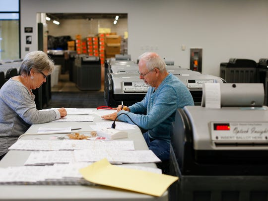 Volunteers Patty Mckee and Rod Martin record votes on test ballots to make sure the number of votes matches with what the machines record during testing of the voting machines by the Greene County Clerks office on Thursday, Oct. 27, 2016 in preparation of the Nov. 8 election.