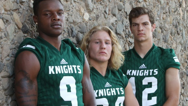 Shasta College football players, from left, Davonte Robertson, Justin Hellyer and Trent Darms.