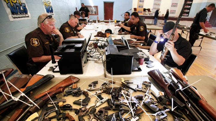 Sheriff's officers enter into a database guns people