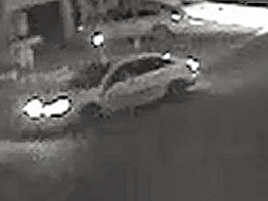 Suspects drove away in a white four-door car