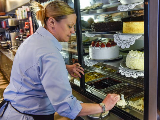 Waitress Jamie Gillette dishes out rice pudding at The Blue Swan.