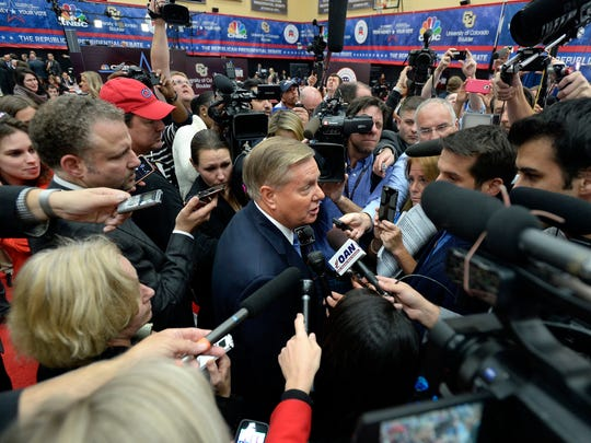 Lindsey Graham speaks to the media after a debate in