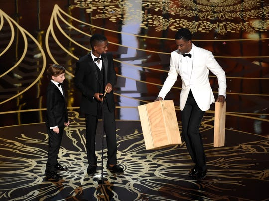 Jacob Tremblay, from left, Abraham Attah, and Chris Rock present the award for best live action short film at the Oscars.