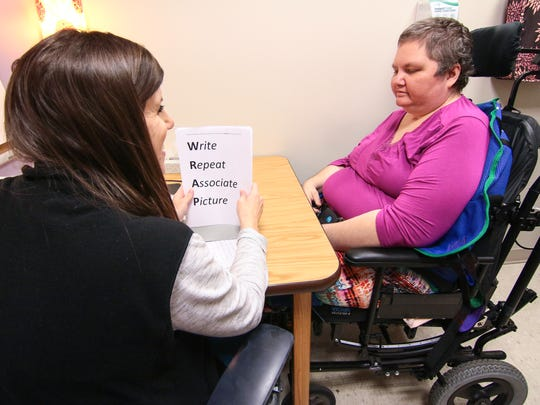 Speech pathologist Danielle Nash, left, asks Dee Loner of Honea Path  to repeat a list of things she should during a therapy session at  Roger C. Peace Rehabilitation Hospital in Greenville.