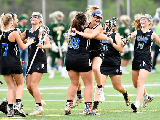Kennard-Dale celebrates a 9-8 win over Susquehannock,