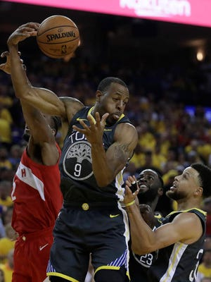 Andre Iguodala (9), traded by Golden State to Memphis over the offseason, appears set to join the Miami Heat as part of a six-player deadline deal. The 36-year-old Iguodala, who never played for the Grizzlies, has previously been with Denver and Philadelphia.