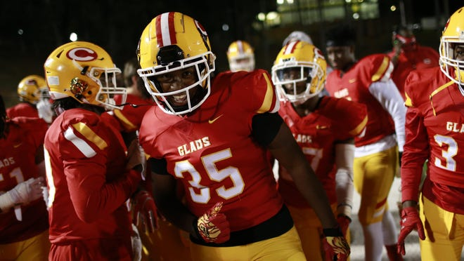 Clarke Central's Will Richardson (35) celebrates with his teammates after scoring a touchdown during an GHSA high school football game between Clarke Central and Loganville in Athens, Ga., on Friday Nov. 6, 2020.