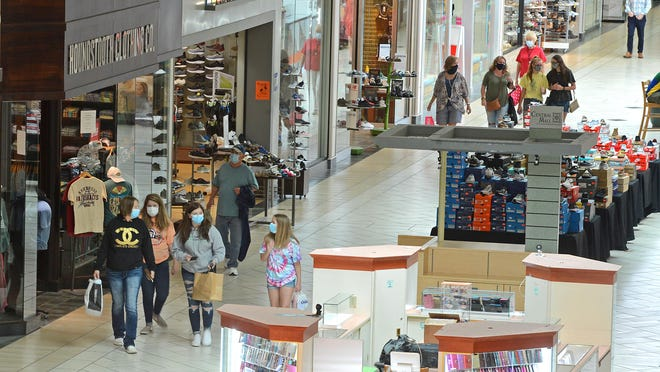 Shoppers stroll through Central Mall in Fort Smith on Wednesday, July 29, 2020. This weekend back-to-school shoppers in Arkansas can take advantage of the annual sales tax holiday.
