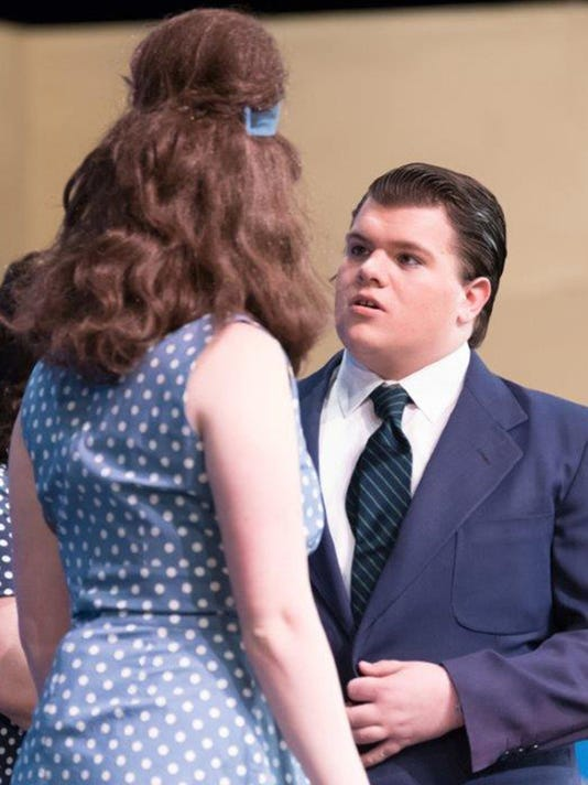 """Jeshua (Jesse) Myers (J. Pierrepont Finch), right, talks with Hannah Jemison (Rosemary), left, in the South Western High School production of â  How To Succeed In Business Without Really Trying.â   Jesse was awarded Best Male Performer at the York County High School Musical Theater Showcase â """" ENCORE program on April 19. Jesse also received a $1,000 scholarship at the event. (Photo courtesy of JB Photography) Submitted"""