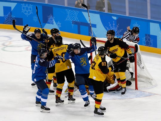 Mika Pyorala (37), of Finland, celebrates after scoring a goal against Germany during the first period of the preliminary round of the men's hockey game at the 2018 Winter Olympics in Gangneung, South Korea, Thursday, Feb. 15, 2018. (AP Photo/Matt Slocum)