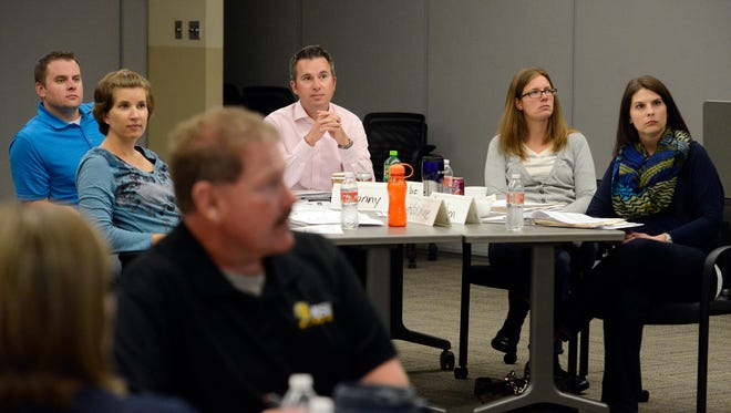 Employees sit in a leadership development seminar Tuesday afternoon at Sammons Financial Group, Sept 16, 2014.