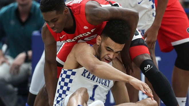 Kentucky's Sacha Killye-Jones battles Georgia's Teshaun Hightower for control Friday afternoon in the 2018 SEC Tournament at the Scotttrade Center in St. Louis.