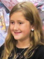 Noelle Osborn, 9, of Elmira, was the 2014 Arctic League bell ringer.