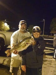 Wayne and Fisher Holmes with the big fish at the Henderson