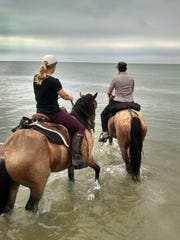 Marine City track and field coach Kristen Humble participated in a horseback riding trek across the state of Michigan this summer.